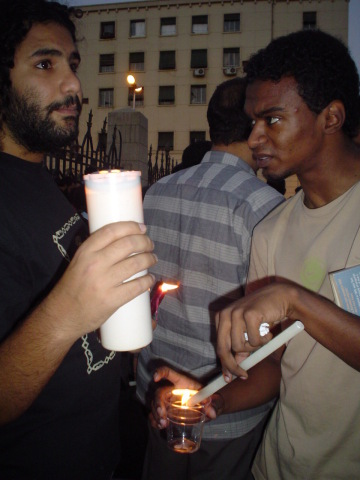 Lighting candles at a Black Friday protest