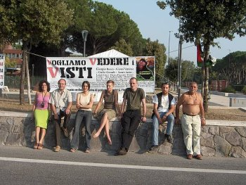 The seven hunger strikers on September 3, the forth day of the protest, in front of the banner:
