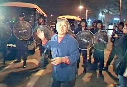 The senior woman accused the riot police of subduing citizens with no weapon