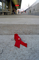 Red Ribbon on Sidewalk