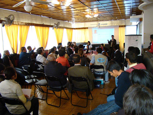 Audience at information meeting via ariniaina