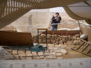 Joseph Dana documenting new construction at an outpost near the settlement of Susya.
