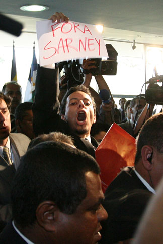 "André Dutra is seing holding a ""Get out Sarney!"" flyer."