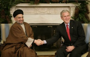 U.S. President George W. Bush welcomes Sayyed Abdul Aziz Al Hakim to the White House Monday, Dec. 4, 2006. (Photo by White House, taken from Wikimedia Commons)