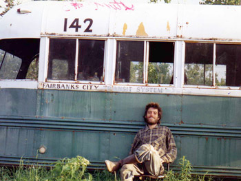"Christopher McCandless in the front of the ""Magic Bus"" (photo found undevelopped in his own camera)"
