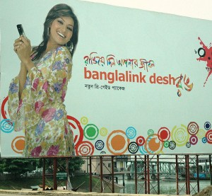Banglalink cell phone excitement in advertisement, Dhaka, Bangladesh, by Wonderlane (Creative Commons)