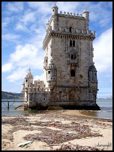 Tower of Belem in Portugal surrounded by garbage. Photo by Flickr user starrynight1.