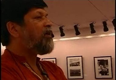 Shahidul Alam commentates on the images in a live web stream after the exhibition had been closed. Image courtesy Media Helping Media