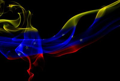 Photo of Venezuelan flag in smoke by ··· Mango Verde con Sal ··· and used under a Creative Commons license.