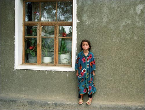 A Girl By The Window, photo by Umida Akhmedova, courtesy of Fergana.ru