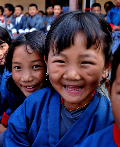 Happy Faces From Bhutan. Image by Flickr user laihiu and used under a Creative Commons license