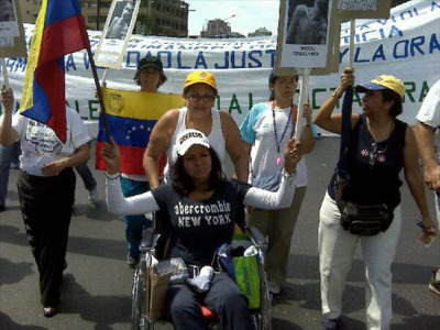 Photo of Elena Brito at demonstration courtesy of Brito and Habla Venezuela.
