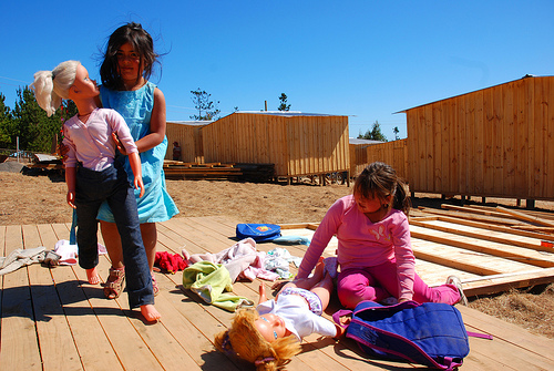 "Girls playing on a ""mediagua"" (emergency housing unit) in a displaced persons camp in Lipimávida, Vichuquén, Maule Region. Photo taken by Rodrigo Alvarez and used under a Creative Commons license."