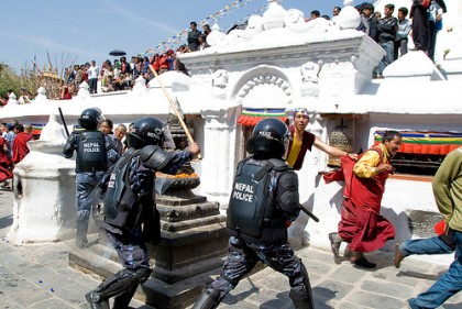 Lathi charge on Tibetan protest in Kathmandu. Image by Flickr user Buddha's Breakfast. Used under a Creative Commons License