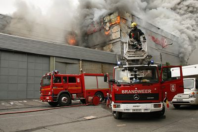 Firefighters attempting to extinguish fire at La Polar supermarket by Juan Eduardo Donoso and used under a Creative Commons license.