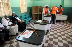 Staff with the National Elections Commission prepare ballots at a polling station in Khartoum, Sudan.
