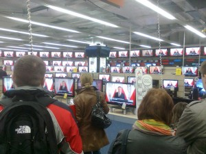 Warsowians looking at premier tusk's speech, photo by alexander p.