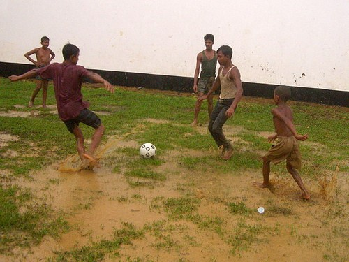 Playing soccer in the rain. Image By Flickr user Vipez. CC BY-NC-ND
