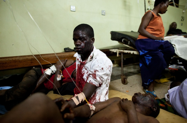 Victims of two deadly bomb blasts in Kampala wait for treatment at Mulago Hospital.