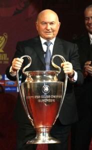 Yuri Luzhkov holding a football trophy