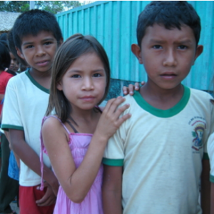 Kids lining up to receive health care along the border of the Amazon river in Brazil