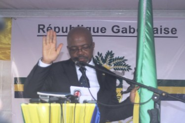 André Mba Obame swears himself in as 'President' of Gabon. Image by Jean-Pierre Rougou.