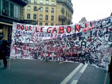 Gabonese activists demonstrating against official Gabon President Ali Bongo in Paris, France on February 26, 2011. Image by author.