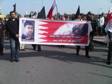 "Banner reads: ""The blood of the martyr falls in the Hand of Allah, and when it does, it grows"". Image posted by Twitter user @Jolly1412."