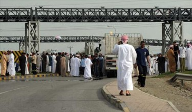 Pro reform protesters block the Sohar Port entrance