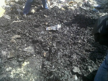 The charred remains of dossiers burnt at the State Security headquarters in Nasr City