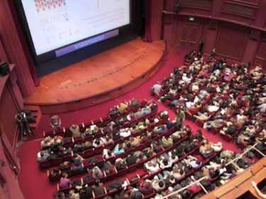 Audience at Thessaloniki Documentary Festival. Screenshot from YouTube video by tbihlaz.