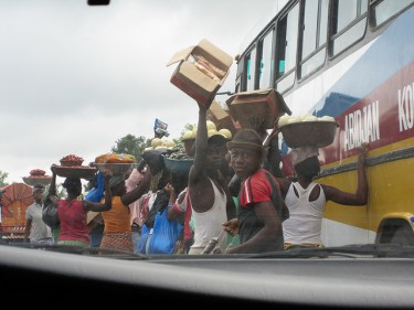 Roadside businesses in Abidjan, Côte d'Ivoire. Image by Flick user CJR836 (Creative Commons License).