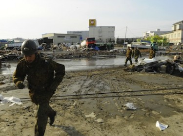 Self Defence Forces arrive at the scene of the tsunami in Japan. Image by cosmobot, copyright Demotix (13/03/11).