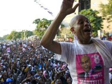 Haitian presidential candidate Michel Martelly in front of thousands of supporters at a rally in capital Port au Prince. Image by Jose Guzman, copyright Demotix (25/11/2010).