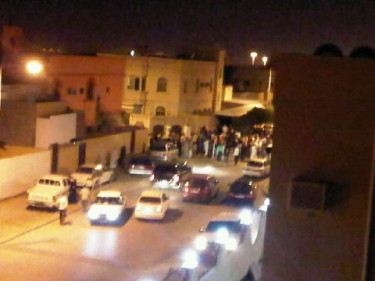 Neighbourhood gathers in Hamad Town curious of what has been happening
