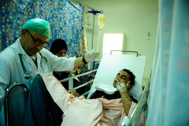 Young man being treated at hospital after the fight in Hamad Town