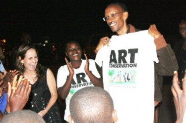 President Paul Kagame holding a t-shirt from Art of Conservation. Photo courtesy of SavyKenya