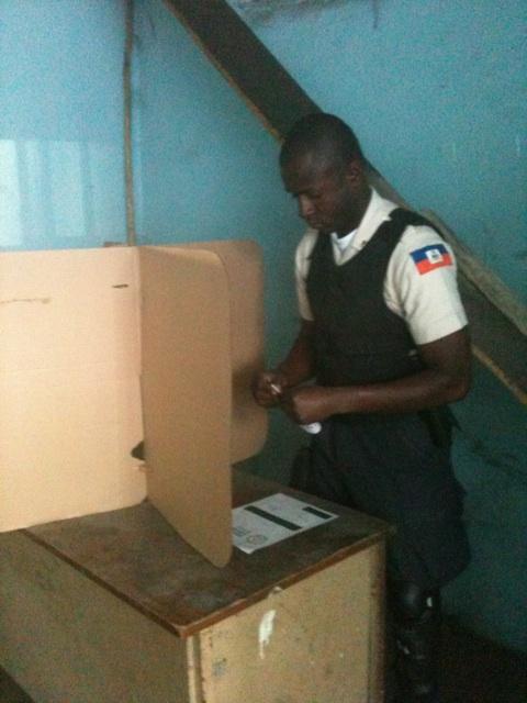"""@esfaceblack: """"HNP (Haitian Nat'l Police) proudly voting."""""""