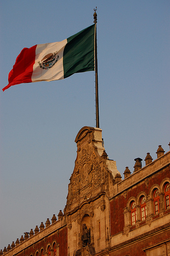 Mexican flag at the national palace by Flickr user Omar Omar (CC BY-NC 2.0).