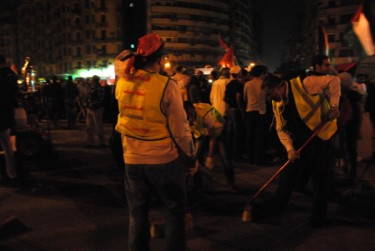 Tahrir at night. Youth cleaning the square after a long day - Twitpic photo by Lilian Wagdy
