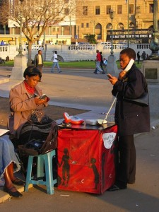 Telephone entrepreneur on the streets around Church Square, Pretoria, South Africa. Image by Flickr user The Wandering Angel (CC BY 2.0).