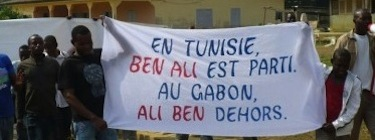 "Meyo-Kye, North Gabon, 2 February, 2011. Banner reads: ""In Tunisia, Ben Ali left. In Gabon, Ali Ben out."""