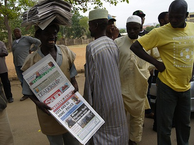 Newspaper vendor outside a polling station during the 2011 elections in Nigeria. Image by Flickr user ComSec (CC BY-NC 2.0).