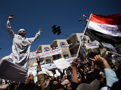 Protester takes part in the funeral of Abdullah Hamid al-Jaify, an anti-government activist killed in clashes with the police, in March 2011 in Sana'a, Yemen. Image by Giulio Petrocco, copyright Demotix (11/03/11).