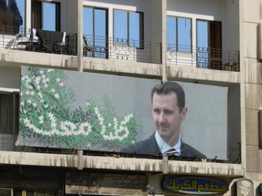 Street poster featuring Syrian President Bashar al-Assad. Image by Flickr user watchsmart (CC BY 2.0).
