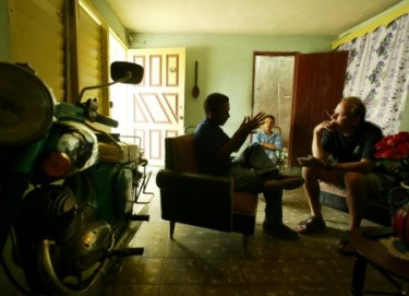 Tracey Eaton interviewing a man in Baracoa, Cuba. Posted with permission of Eaton.