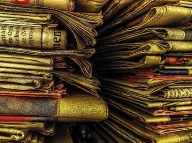 Old newspapers. Image by Flickr user ShironekoEuro (CC BY 2.0).
