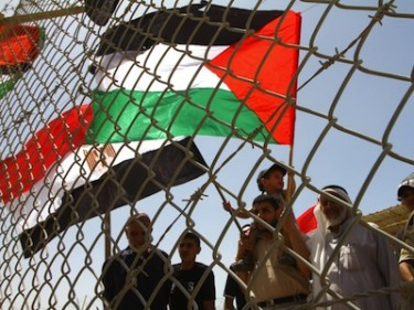 Palestinians take part in a rally at the gate of Rafah border crossing. Image by ASHRAF AMRA copyright Demotix (28/05/11).