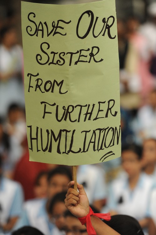 Students hold placards denouncing sexual abuse at their school, as they gather at the Central Shaheed Minar. Image by Safin Ahmed. Copyright Demotix.