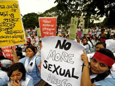 Students hold placards denouncing sexual abuse at their school, VNC, Bangladesh. Image by safin ahmed, copyright Demotix (12/07/2011).